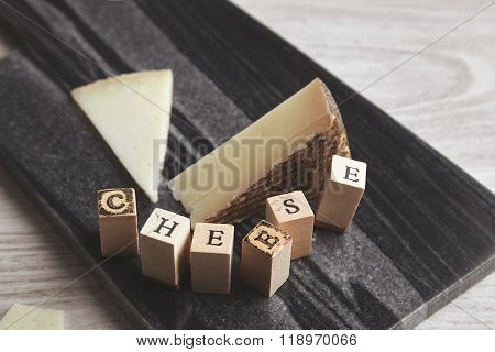 Close Focus Wooden Letters Side Goat Cheese Isolated