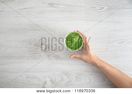 Woman Hand Takes Her Matcha Tea Top View