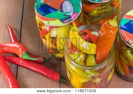 Top View On Open Pickled Chilli Peppers In Glass Jar With Fresh Chilli