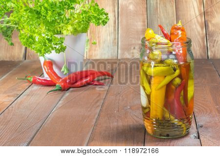 One Glass Jar Pickled Chilli Peppers With Fresh Chilli And Parsley