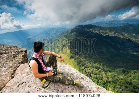 Young traveler is on top of Pha Luong mountain, Moc Chau, Vietnam