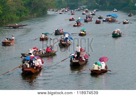 HANOI, VIETNAM - MARCH 30, 2015: Tourist sit on boat to visit HUONG Pagoda. HUONG Pagoda Festival is the biggest and longest annual festival in Vietnam.