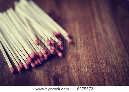 Red matchstick background on wood with copy space