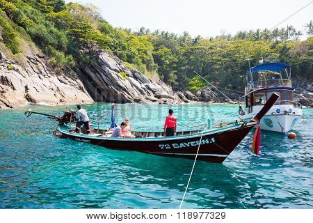 PHI PHI ISLANDS, THAILAND - CIRCA FEBRUARY, 2015: Traditional Thai boats on the shore of the island of Phi Phi Islands in the Andaman Sea. Islands is very popular with tourists from all over the world
