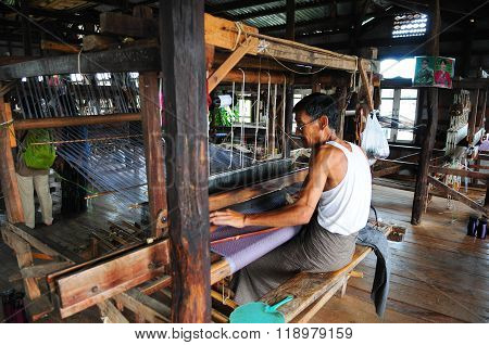 An unidentified Burmese woman make silk from lotus in Inle Lake, Myanmar.