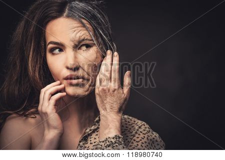 Aging and skin care concept. Half old half young woman.