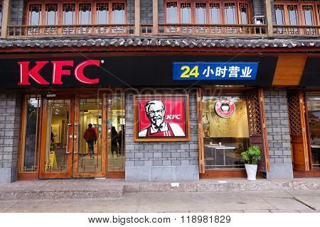 LIJIANG, CHINA, April 28, 2015: KFC instant food shop in Lijiang ancient town in Yunnan, China. Lijiang is one of the most beautiful cities of China with a rich culture and history.