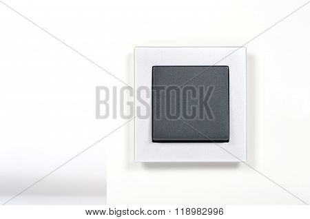 Light Switch With Silver Glass Frame On The Wall