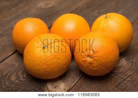 Fresh Juicy Oranges On The Wood Background