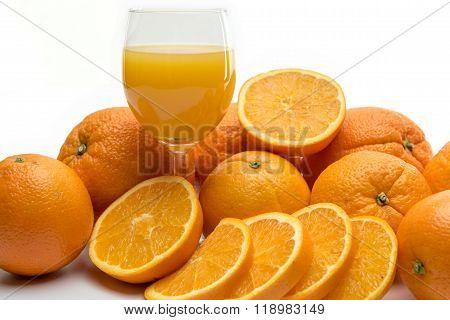 Fresh Orange Juice And Fruits On White Background