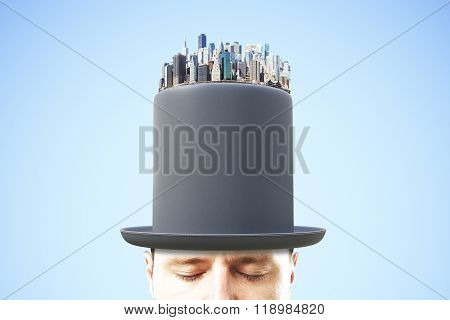 Man Head In Black Cylinder With Financial District On The Top