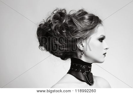 Doutone portrait of young beautiful girl with stylish hairdo and fancy steampunk collar