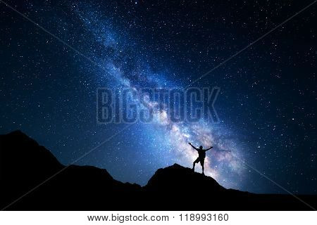 Milky Way. Night Sky And Silhouette Of A Standing Man