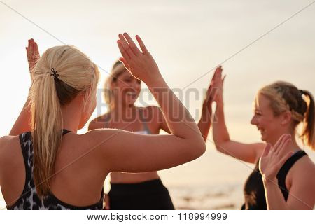 Runners Giving High Five