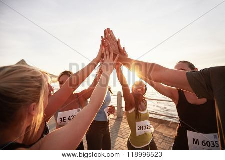 Marathon Runners Giving High Five