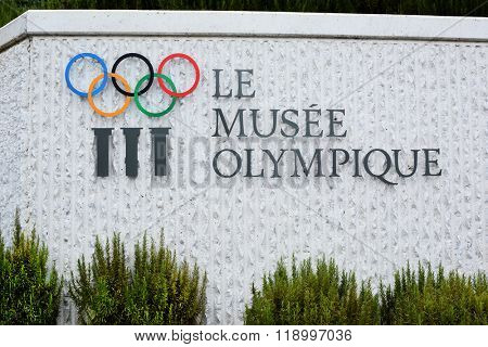 LAUSANNE, SWITZERLAND - JULY 5, 2014: Fountain and Sign at the Olympic Museum. The Museum has more than 10,000 pieces and hosts over 250,000 visitors a year.