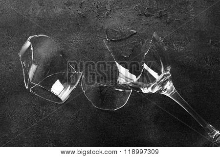 Broken wine glass on grey background