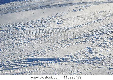tire tracks on street after snow, can be used for design background