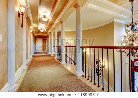 Elegant Hallway With Black Railing.