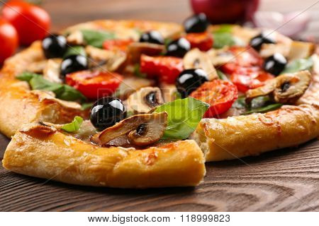 Sliced delicious tasty pizza, closeup