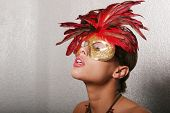 image of pouty lips  - Gorgeous biracial woman with red mask - JPG