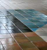 stock photo of grout  - ceramic tile floor with interesting pattern fading into the distance - JPG