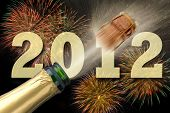 stock photo of new years celebration  - popping champagne and firework at new year party 2012 - JPG