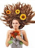 Young Beautiful Brunette Woman With Scattered Long Hairs And Sunflower