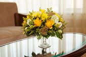 picture of flower arrangement  - Flowers in a hotel room on coffee table - JPG