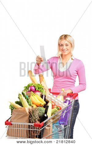 A smiling woman checking her shopping receipt isolated on white background