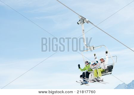 Winter - ski vacation - family on ski lift - space for text