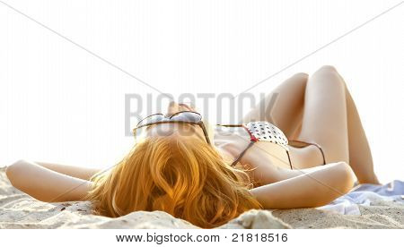 Beautiful Redhead Girl At Beach In Sunrise Time.