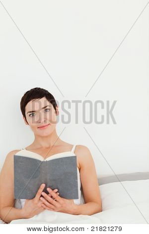 Portrait Of A Brunette Holding A Book