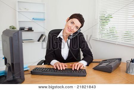 Professional Secretary Answering The Phone