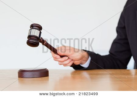 Feminine Hand Knocking A Gavel