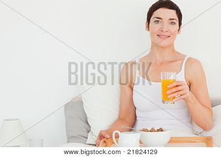Close Up Of A Woman Drinking Orange Juice