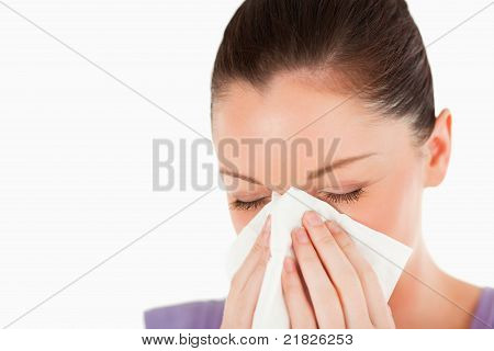 Portrait Of An Attractive Woman Sneezing While Standing