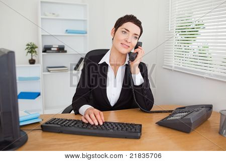 Secretary answering the phone in her office