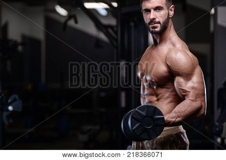 poster of sexy strong bodybuilder athletic fitness man pumping up abs muscles workout bodybuilding concept background - muscular bodybuilder handsome men doing fitness health care exercises in gym naked torso