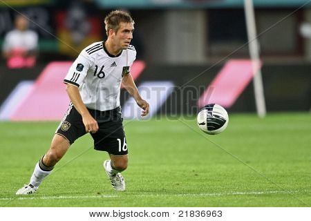 VIENNA,  AUSTRIA - JUNE 3 Philipp Lahm (#16, Germany) prepares to center the ball during the EURO 2012 soccer game on June 3, 2011 in Vienna, Austria. Austria loses 1:2