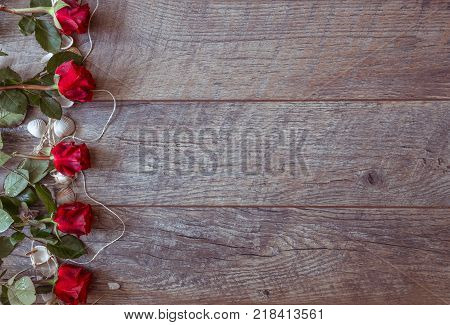 poster of Valentines day background with red roses and shells. Wedding background. Top view, copy space. Mother's, Valentines, Women's Wedding Day concept.