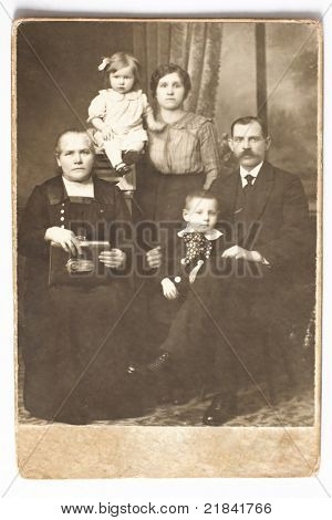 Old photo of family: husband, wife, children and the grandmother. Photo taken before 1917.