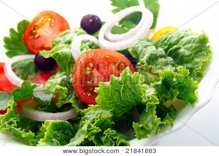 tasty tomato salad on a white cup