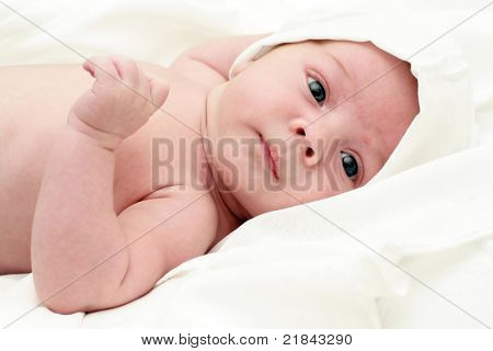 portrait of a close-up, infant lying on the bed