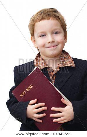 Retrato de un niño con una Biblia en la mano