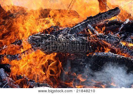 Blackened Logs in Flames