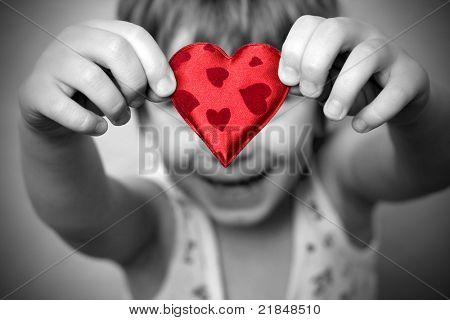 two hands holding a red heart