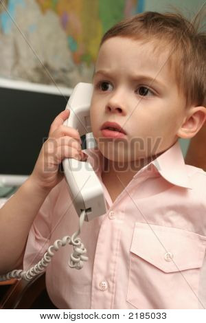 The Boy Speaks By Phone In Working Hours