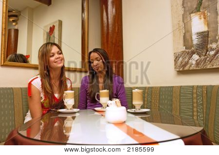 Two Mulatto Girls Sit In A Cafe With Mirrors