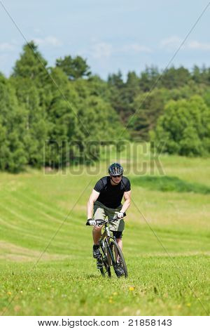 Sportive Man Mountain Biking Uphill Sunny Meadows